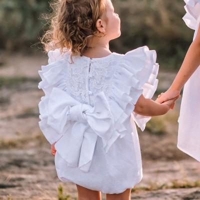 White linen baptism or christening romper
